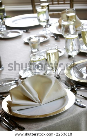 tables set for fine dining during a wedding event. Shallow depth of field.