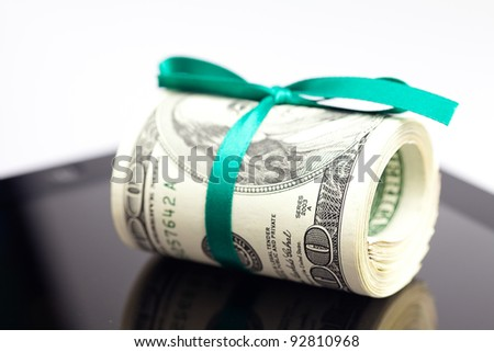 tablet and tube of dollars  isolated on white