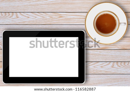tablet computer and coffee cup