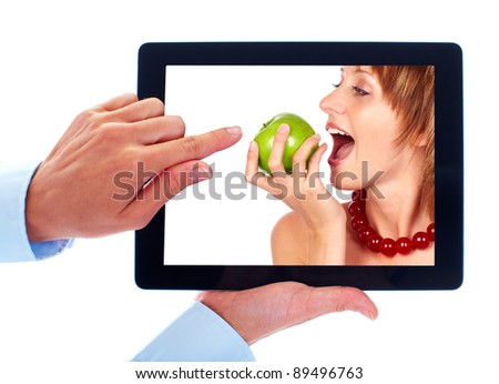 Tablet computer and woman with apple. Isolated on white background.
