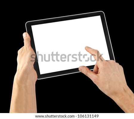 tablet computer isolated in a hand on the black backgrounds.