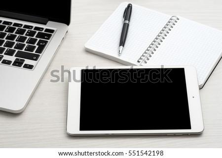tablet computer on desk in...