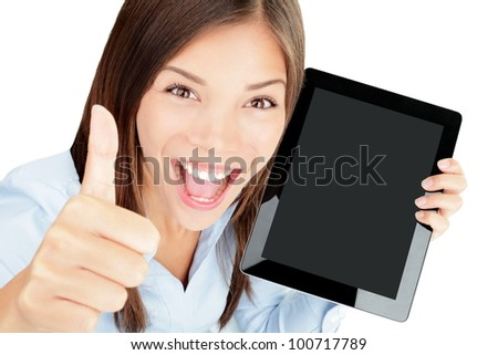 Tablet computer woman happy excited showing touch pad screen and thumbs up. Beautiful winning mixed race Asian Chinese / Caucasian female model.