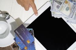 Tablet, credit card and bankroll.