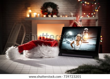 tablet in christmas interior and Ice queen woman
