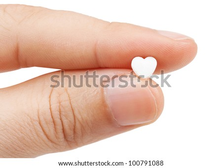 tablet in the fingers isolated on a white background