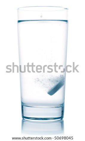 tablet in water glass isolated on white