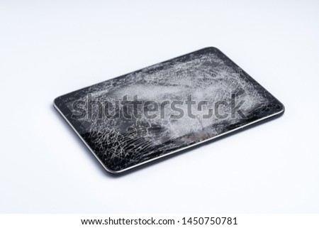 Tablet isolated on white background. The glass of the touchscreen is broken. #1450750781