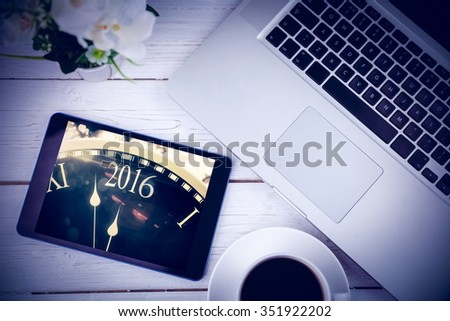 Tablet on desk against new year countdown graphic