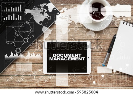 Tablet on desktop with document management text. #595825004