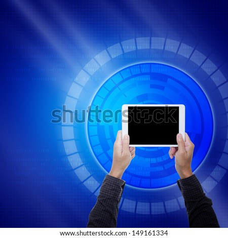 Tablet on hands with blue digital background