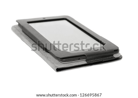 Tablet PC in a case close-up, isolated on white background.