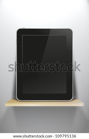 tablet pc, on wood shelves and white wall background