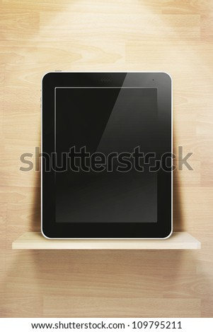 tablet pc, on wood shelves and wood wall background