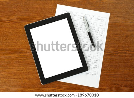 Tablet PC, paper and pen on wooden background   - stock photo