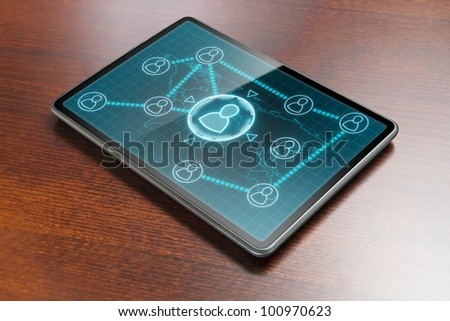 Tablet PC showing structure of social network on it's screen, laying on wooden table.