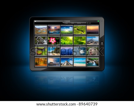 Tablet PC with photo gallery - stock photo