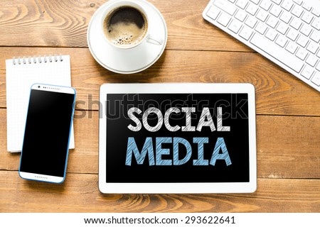 Tablet pc with social media and coffee