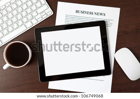 tablet touch computer gadget on the table of a businessman