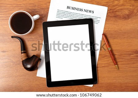 tablet touch computer gadget on the table of businessman ceo