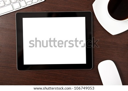 tablet touch computer gadget on the table with a businessman