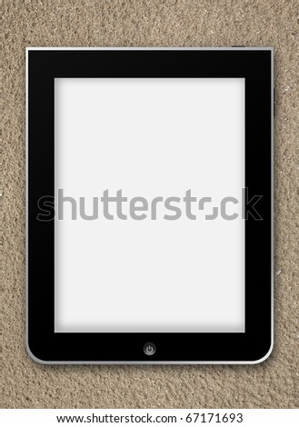 Tablet touchscreen with blank screen for your text or image on sand background
