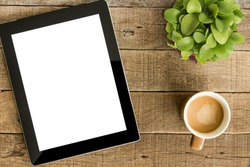 tablet white screen display and coffee on wood table