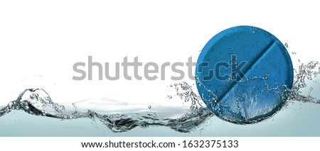 Tablet with a chemical additive for washing dishes in a spray of water. Photo stock ©