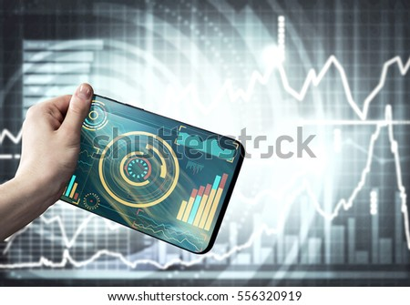 Tablet with infographs in business person hand #556320919