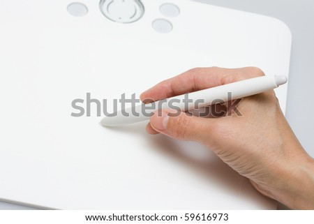 tablet with pen on gray