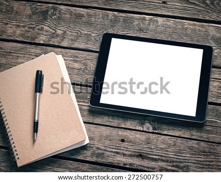 Tablet with ring binder on desktop Clipping path included