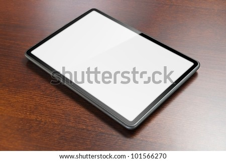 Tablet with screen as copy space laying on table.