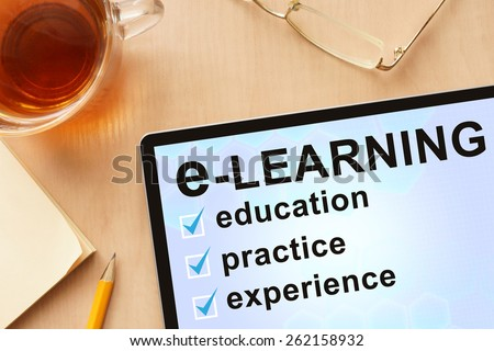 Tablet with words e-learning. Business concept.