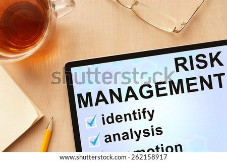 Tablet with words  risk management . Business concept.