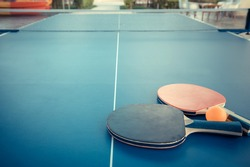 Tabletennis or ping pong rackets and balls on table. Sport concept.