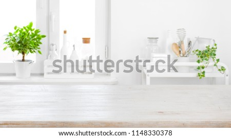 Tabletop for product display with defocused modern pastel kitchen background