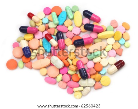 Tablets and capsules over white background