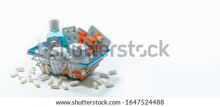 Tablets And Medicines In The Shopping Cart On A White Background. Layout for advertising. The Concept Of Medicine And Pharmacy.