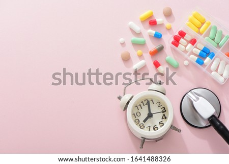 Tablets and stethoscopes on a pink background