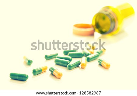 tablets capsules pills yellow green on a white background
