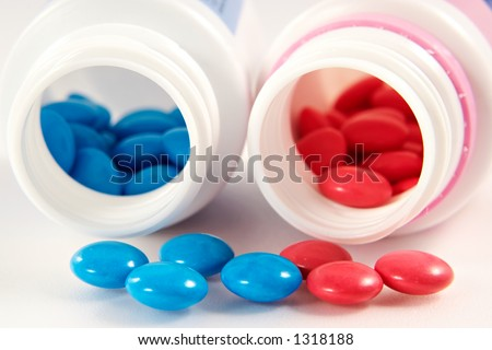 Tablets in a colourful gelatinous environment-useful vitamins