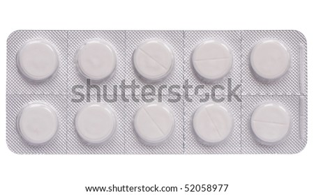 Tablets in push-through strip on white