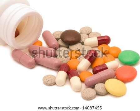 Tablets, pills and vitamins on a white background