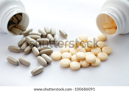Tablets spilling out of container