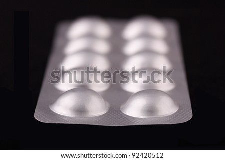 Tablets strip macro view on a black background - stock photo