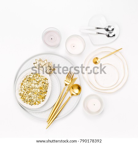Tableware and decorations for serving a festive table.  Plates, wine glasses and cutlery with  candles  on white background. #790178392