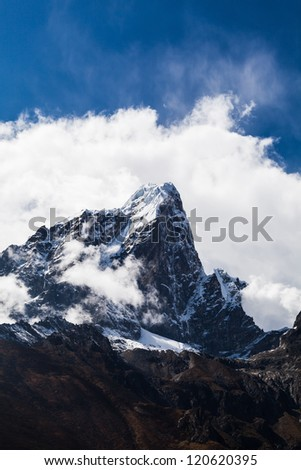 Taboche mountain in Himalayas, Nepal. Mountains landscape over blue sky
