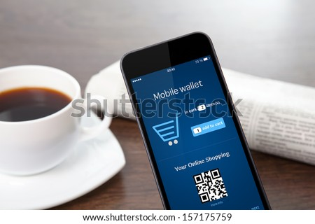 tach phone with mobile wallet onlain shopping on the screen on a table at a businessman in office #157175759