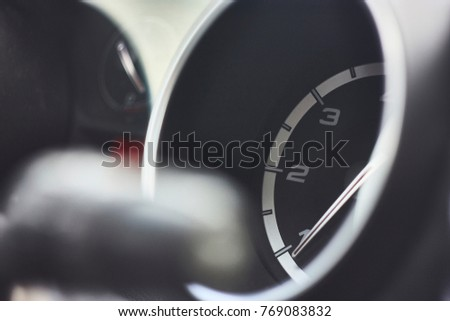 Tachometer with an Italian car hand. Illustrative detail. #769083832