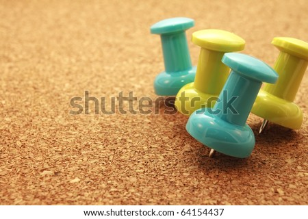 Tacks A group of tacks with corkboard. Horizontal